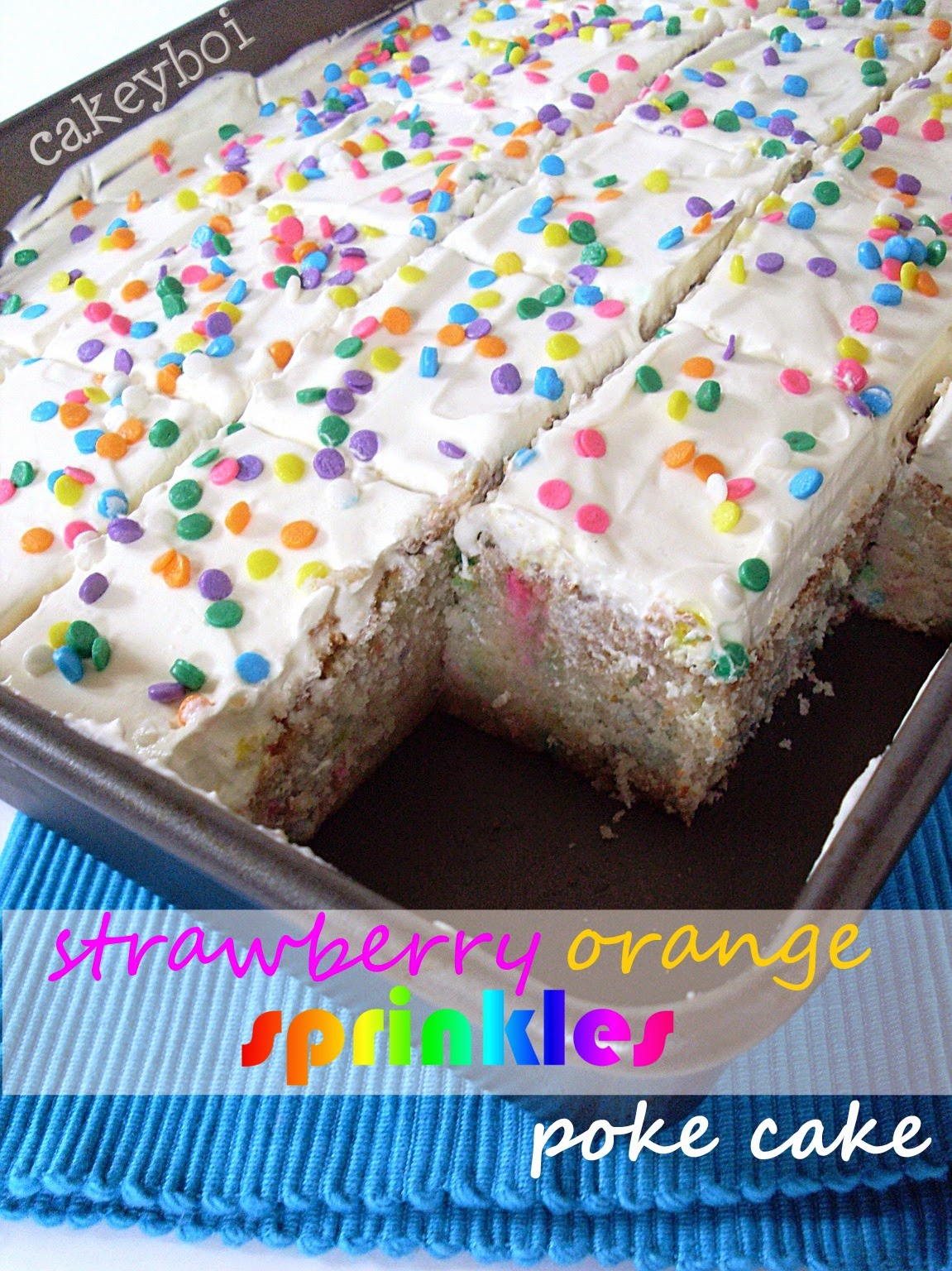 Strawberry flavour white cake with orange jelly and sprinkles