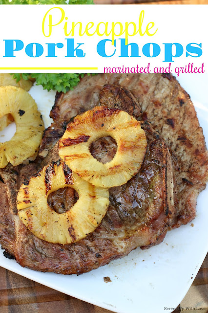 Marinated and grilled pork chops on white platter with sliced pineapples grilled