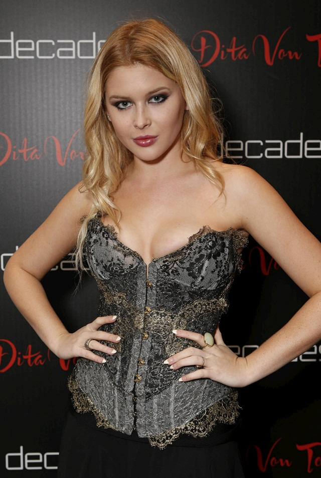 Renee Olstead - Wardrobe Malfunction at Dita Von Teese Collection Launch Party