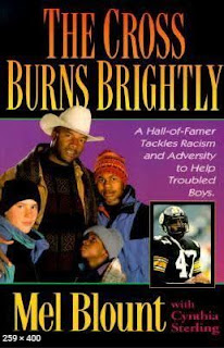The Cross Burns Brightly: A Hall-of-Famer Tackles Racism and Adversity to Help Troubled Boys by Mel Blount book cover with Mel Blount in a cowboy hat with his arms around two boys from the youth home. Mel Blount in Steeler's helmet and jersey inset.