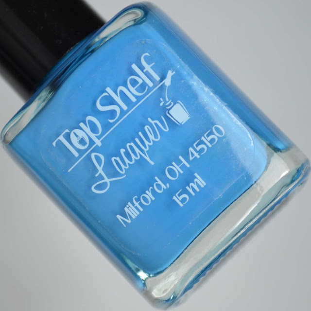 blue nail polish in a bottle