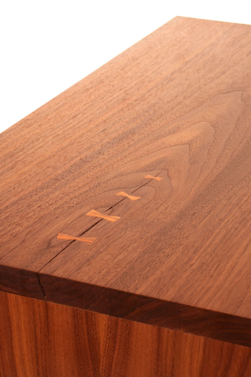The bow tie joints are made of a wood called cocobolo. A real treat to ...