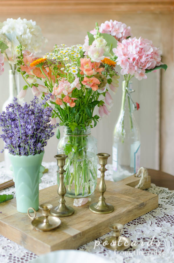 vintage brass candlesticks and fresh flowers