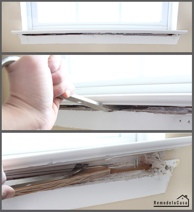 Using a pry bar to remove window sill