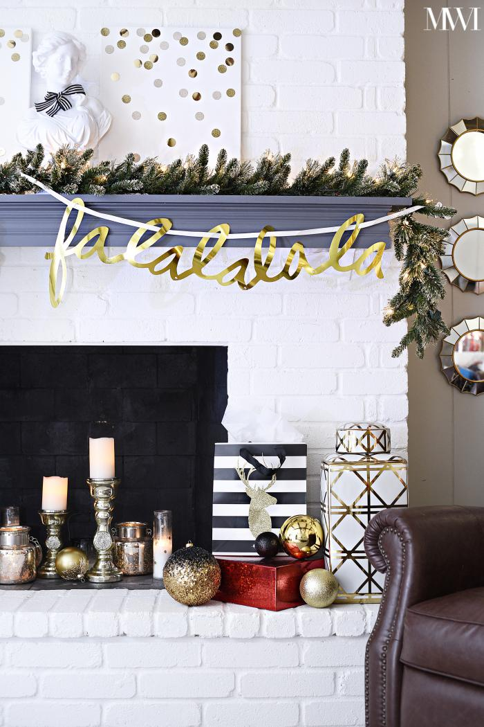 Gold and white holiday mantel decorated for Christmas
