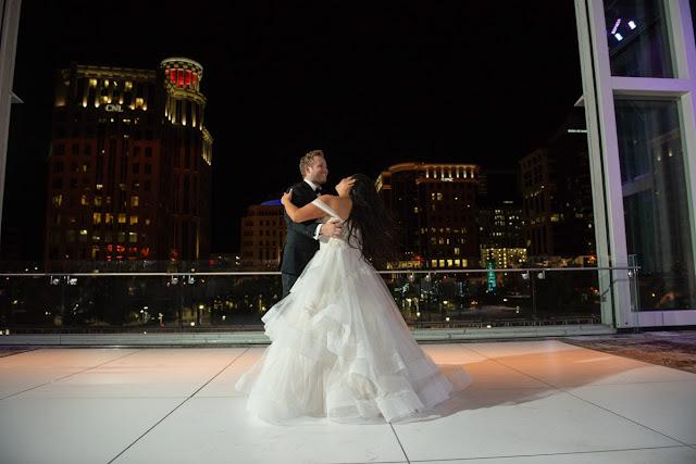 bride and groom dance on rooftop