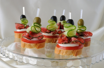 Quick salami canapes with fresh mozzarella and tomato for Canape meaning in english