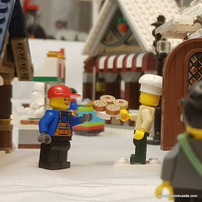 LEGO Winter Village baker with doughnuts