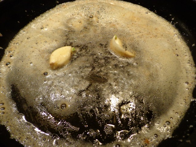 sauté garlic in a mixture of oil and butter