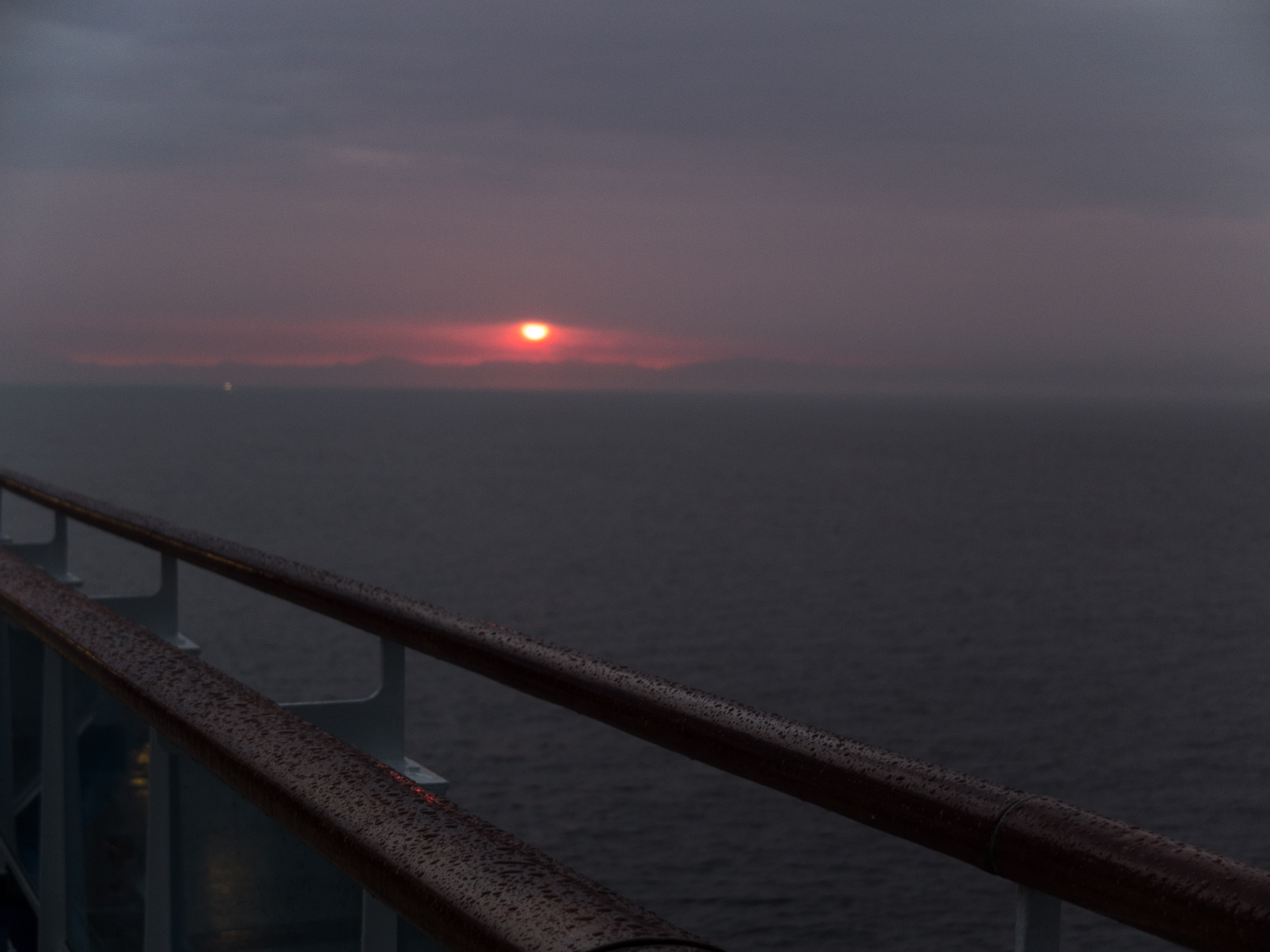 View of sunrise in the Strait of Gibraltar from a cruise ship.
