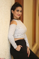 Manjusha in sleevelss crop top and black skirt at Darshakudu pre release ~  Exclusive Celebrities Galleries 037.JPG
