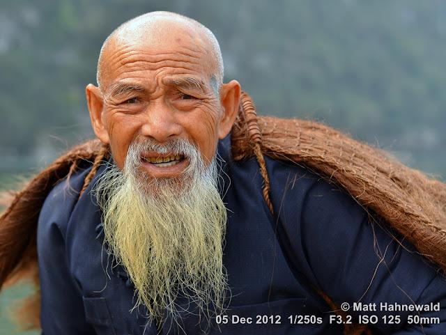 people; Chinese people; Chinese man; portrait; street portrait; headshot; South China; Guangxi province; Xingping; old man; Chinese beard; Li river; old fisherman; close up