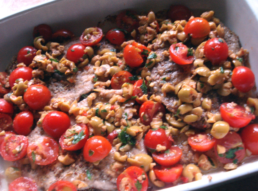 Cover steaks with olive and tomato salsa evenly.