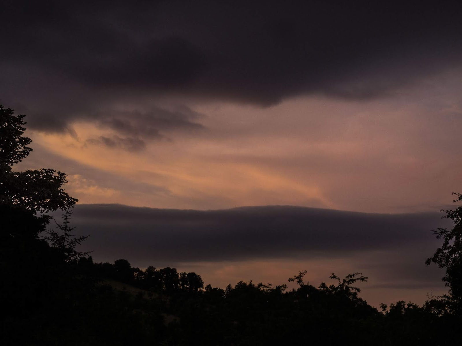 A dark pastel toned sunset sky over the trees in the Boggeragh Mountains, Co.Cork.
