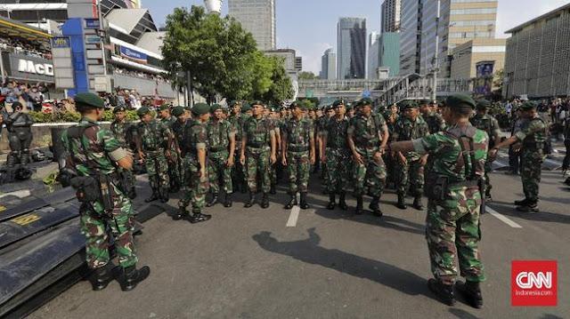Istri Unggah 'Rezim Tumbang', Anggota TNI AD Ditahan 14 Hari