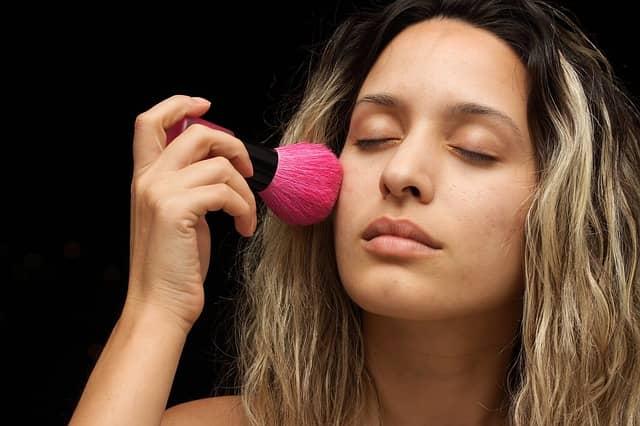 a women doing makeup