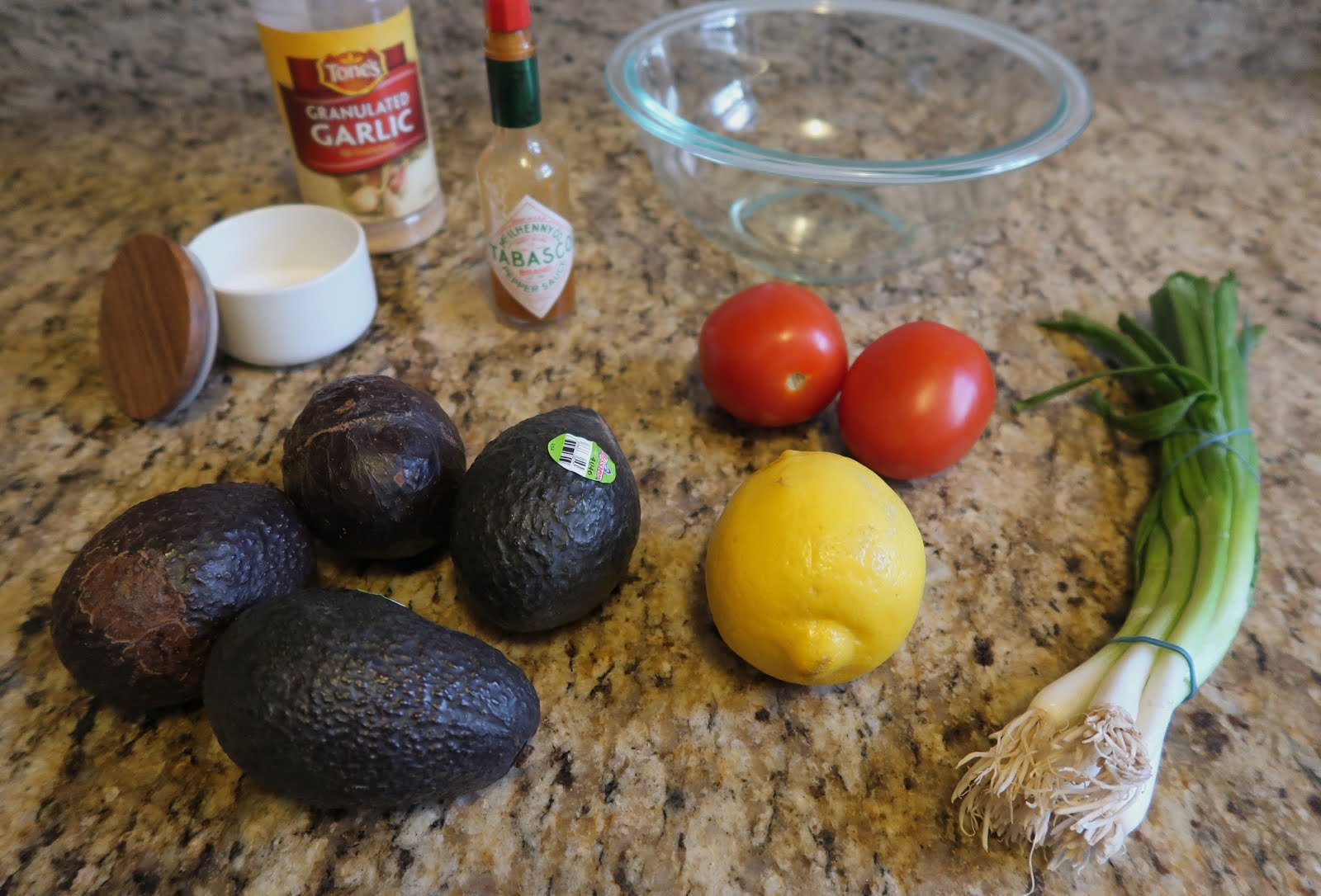 guacamole ingredients recipe avocado lemon tomato green onion salt tabasco garlic bowl