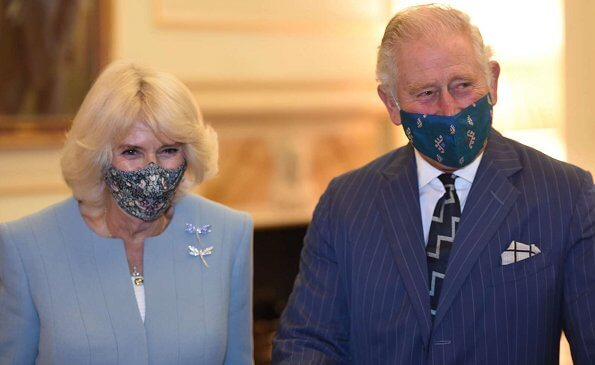 Prince Charles of Wales and Duchess of Cornwall visited the Headquarters of the Bank of England in London. Camilla wore a light blue suit