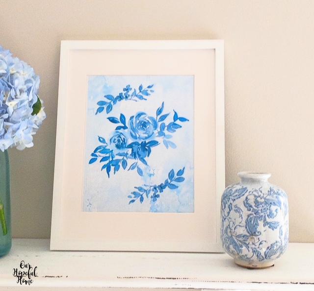blue floral prints white frame flower vase