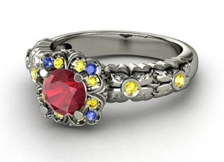 1d8cf254acf21 Em ouro branco, o anel da Branca de Neve tem rubi central rodeado por  safiras amarelas e azuis. US 6 301,00.