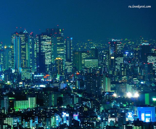 Ночной Токио с высокими домами, с высоты