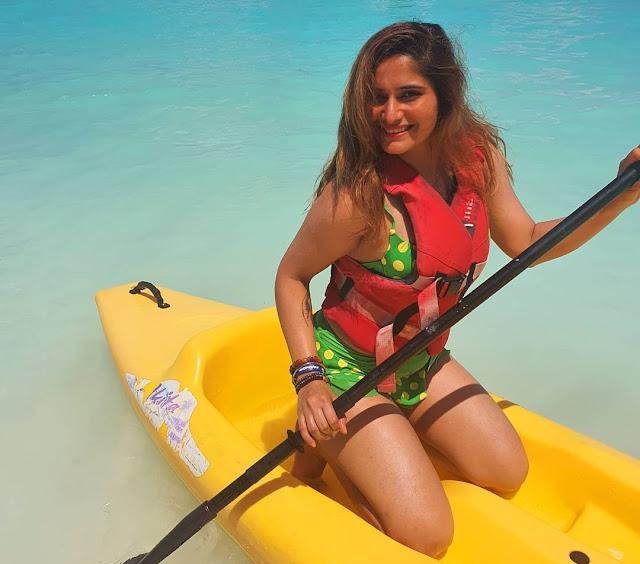 arti-singh-shares-bold-photos-in-green-bikini