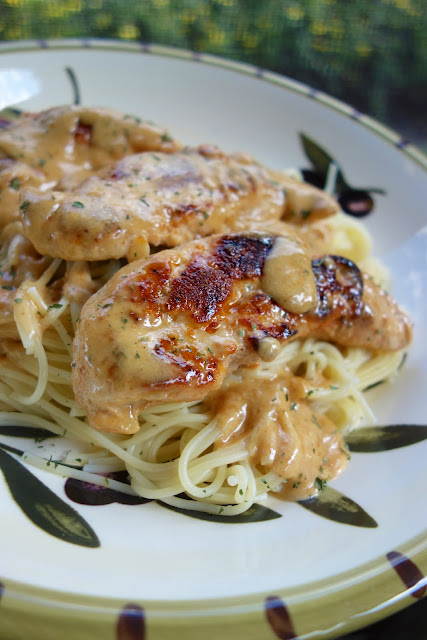 Chicken Lazone - ready in 15 minutes - no prep required! We made this 3 days in a row! Chicken seasoned with salt, chili powder, onion powder, garlic powder and cayenne then simmered in butter and heavy cream. Seriously THE BEST!!! #chicken #easydinnerrecipe