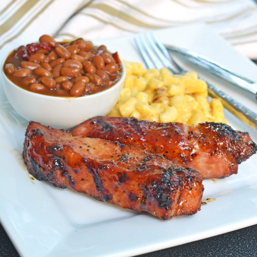 Boneless country-style pork ribs with BBQ beans and creamy mac and cheese.