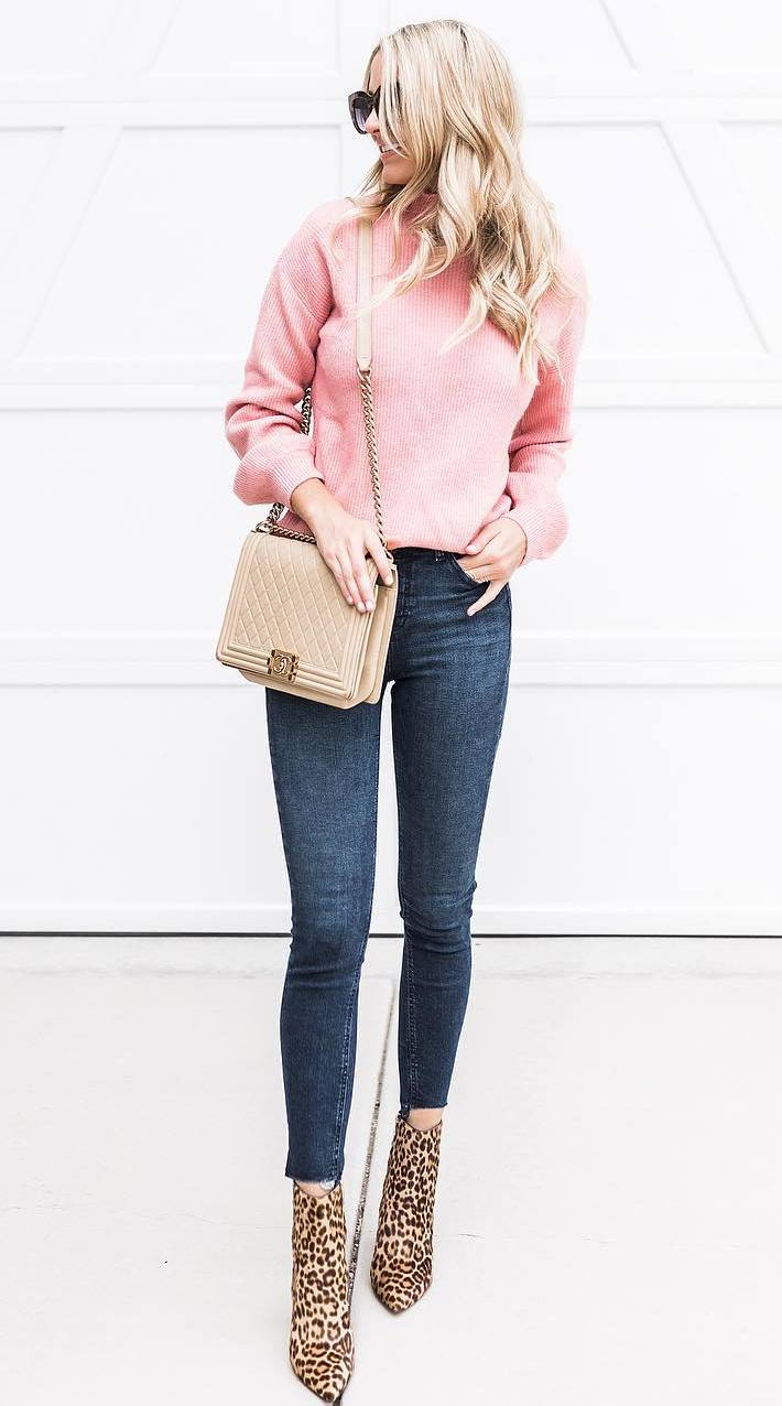 what to wear with a pair of leopard boots : pink sweater + skinny jeans + bag