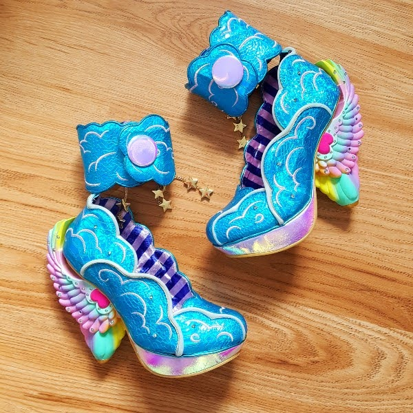 Irregular Choice Dreamscape blue wing heeled shoes on wooden floor