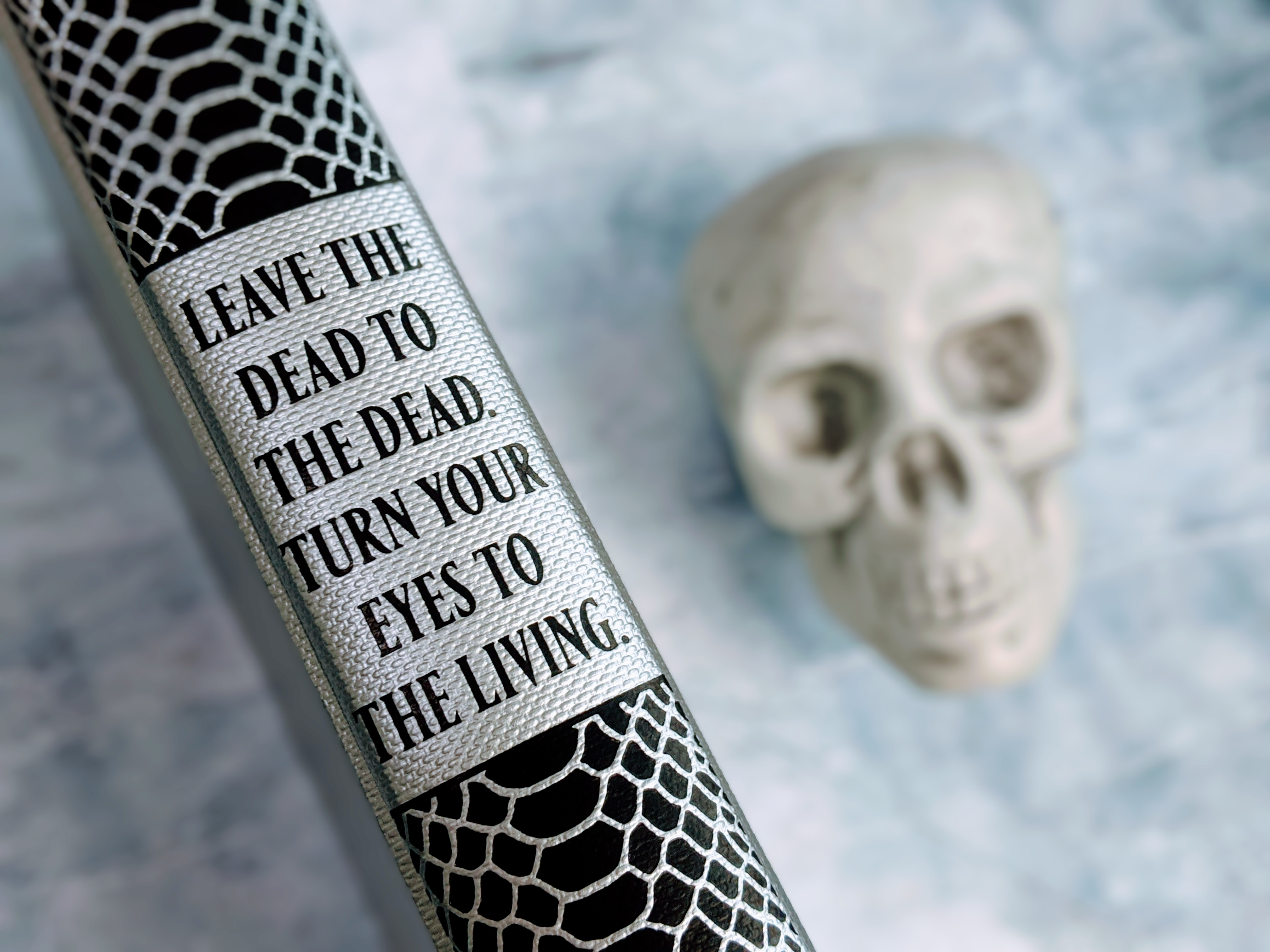 Illumicrate edition spine: Leave the dead to the dead. Turn your eyes to the living.