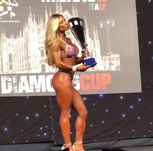 Gentiana Beqa holding the prophy at Bikini Wellness Fitness