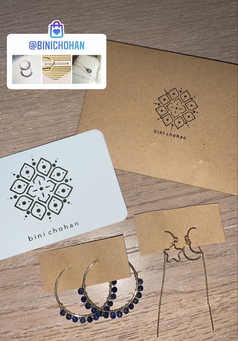 Binichohan order packaging and earrings on a brown surface