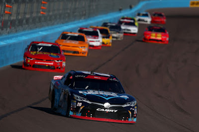 Christopher Bell leads a pack of cars during the NASCAR Xfinity Series  Whelen Trusted To Perform 200 at ISM Raceway in Phoenix, Arizona.