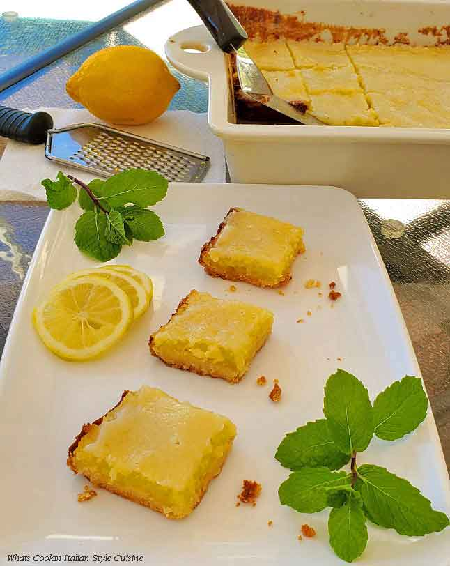 these are a sour cream lemon bar made with fresh lemons, sour cream baked in a shortbread cookie crust