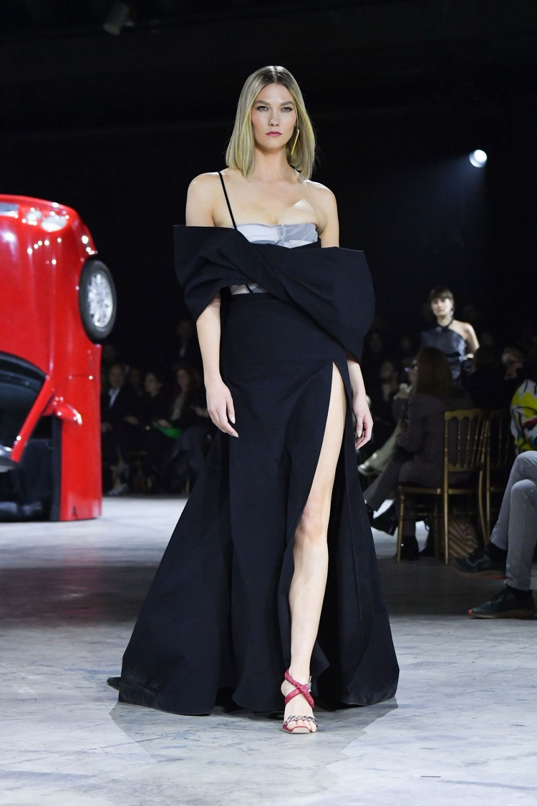 Karlie Kloss flashes her cleavage and toned legs in racy thigh-split corset gown