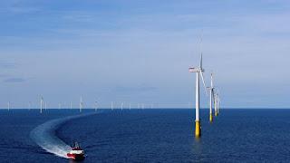 A boat sails past DanTysk wind farm, 90 kilometres west of Esbjerg, Denmark, September 21, 2016. Picture taken September 21, 2016. (Credit: Reuters/Nikolaj Skydsgaard) Click to Enlarge.