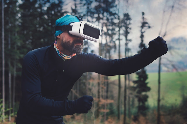 Goofy man in weird outfit and VR headset, out in nature, stop playing video games