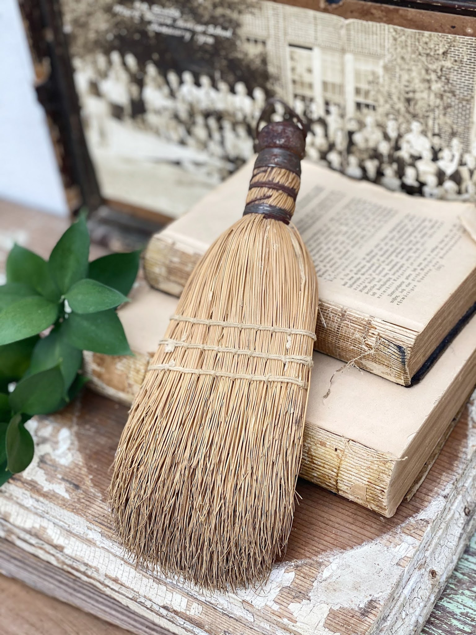 A vintage whisk broom looks great on a wall or in a bowl