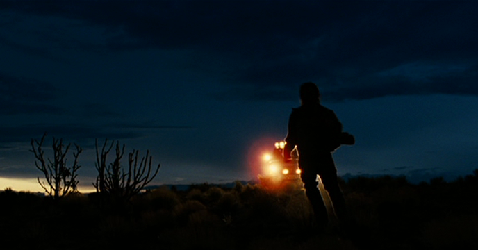 Chase scene in the desert at dawn, Josh Brolin as Llewelyn Moss, Roger Deakins' splendid cinematography adds color and life to the film, No Country for Old Men (2007), Directed by Joel and Ethan Coen