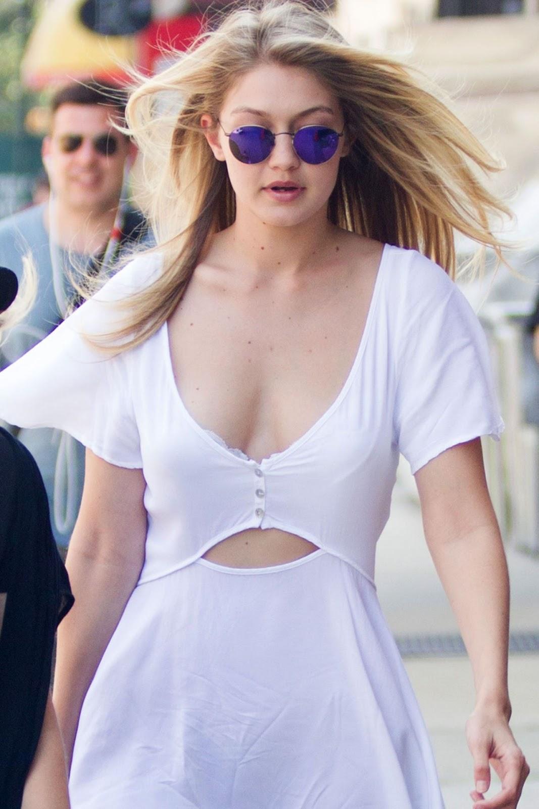 Gigi Hadid shows cleavage in a chic summer dress in NY