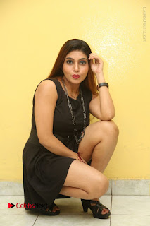Tollywood Upcoming Actress Pooja Roshan Stills in Black Short Dress at Plus 1 Movie Trailer Launch  0242.JPG