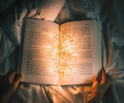 string of lights in open book
