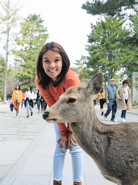 Posing with a deer