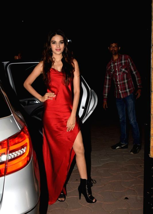 Indian Actress Nidhhi Agerwal Cute Looking Stills In Red Dress ❤