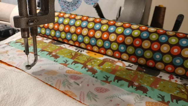 """Quilt-as-you-go 2.5"""" strip baby quilt"""
