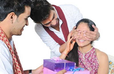 Brothers giving gifts to sister on Rakshabandhan
