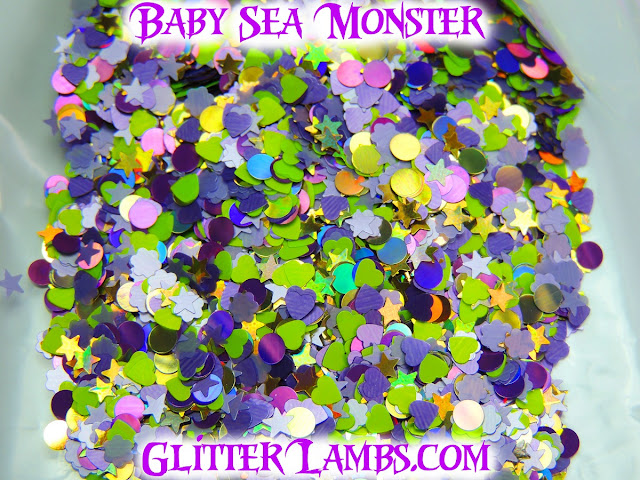 """Our """"Baby Sea Monster"""" loose glitter mix has gold holographic stars, gold holographic dots, purple holographic dots, lilac daisies, neon green hearts and lilac stars."""
