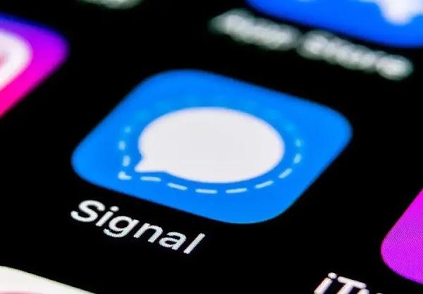Facebook Bans Signal Ads