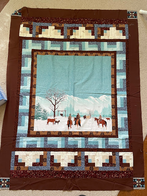 Wallhanging quilt with pieced borders